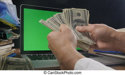 Concept of Money making, your logo on green screen of...