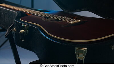 Concept of musical instruments. A man opens the case with a...