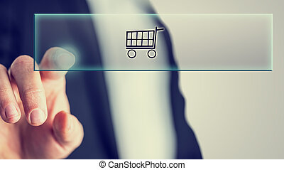 Concept of online shopping - Male hand touching an online...