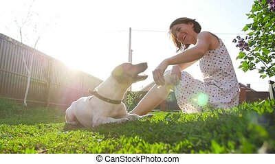 Young woman playing with dog Jack Russell Terrier