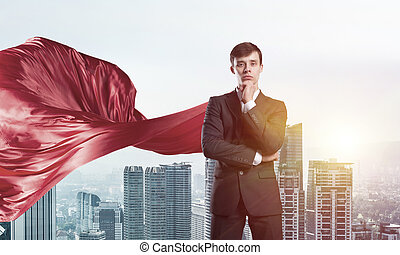 Concept of power and sucess with businessman superhero in big city