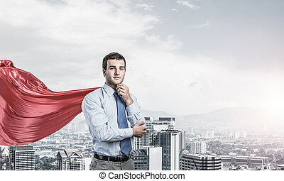 Concept of power and sucess with businessman superhero in big ci