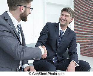 Handshake of colleagues before the meeting
