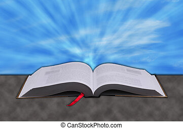 Concept of rays from heaven shining down on a Christian bible