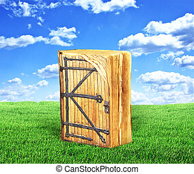 Concept of reading. Ancient book with a door to the magical world of reading on grass. Concept of knowledge.