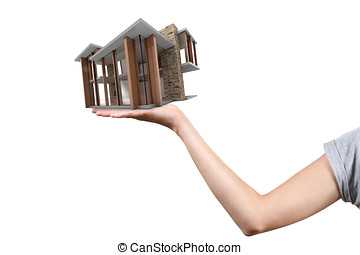 Concept of real estate business: house on the hand