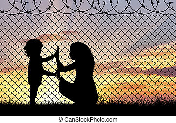 Silhouette of mother and child refugees - Concept of...