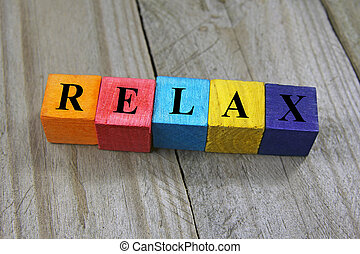 concept of relax word on wooden colorful cubes