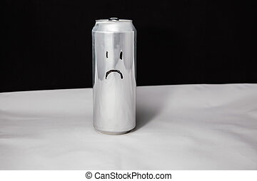 Concept of sad man. melancholy emoticon on aluminium can, Emoji with sorry face. On black background