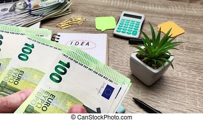 Concept of savings, man counts 100 euro to start his own business