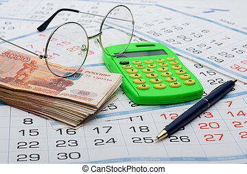 Concept of savings savings for old age, money, pen, calculator and glasses