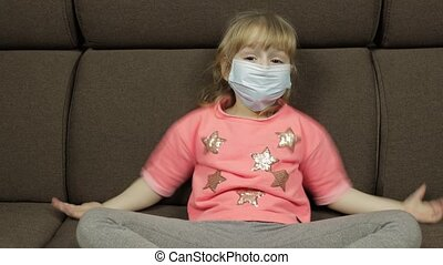 Concept of sick little girl wearing a medical mask. Quarantine. Coronavirus