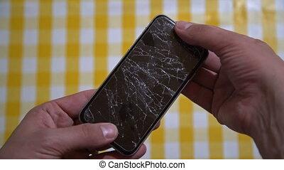 Concept of smart phone with broken screen. Top view of man...