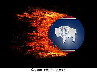 US state flag with a trail of fire - Wyoming