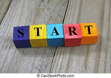 concept of start word on wooden colorful cubes