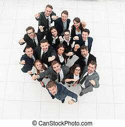 concept of success. numerous triumphant business team . the...