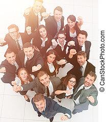 concept of success. numerous triumphant business team
