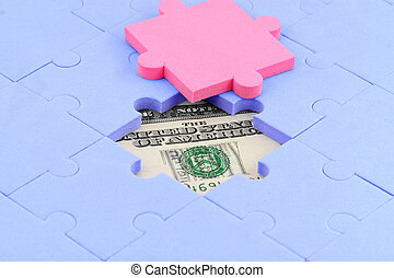 concept of success - us dollar and puzzles close up,...