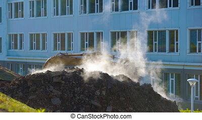 Concept of the breakthrough of underground utilities. steam...