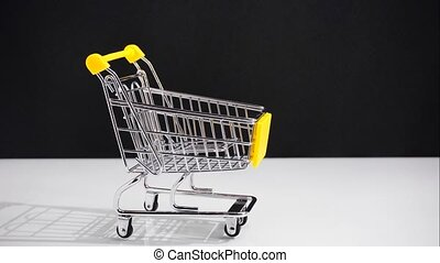 concept of the shopping cart sale movement. Stop motion