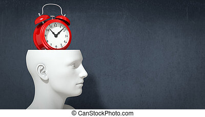 concept of time - one head of a manikin with a vintage alarm...