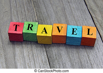 concept of travel word on wooden colorful cubes