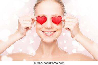 concept of Valentine's Day. woman with a red heart on eyes