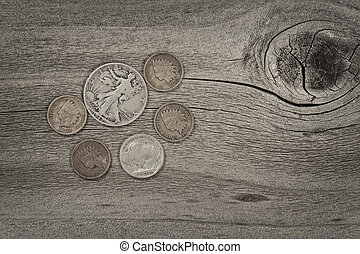 Concept of vintage coins on aged wood - Old United States...