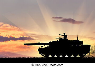 Silhouette of a tank with a soldier - Concept of war....