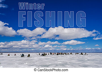 concept of winter fishing. Many men fishermen on the ice of the lake under the blue sky