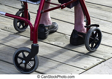 Lower body of a an elderly woman sitting in a wheelchair.
