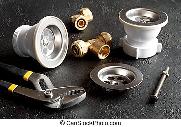 concept plumbing tools on dark background
