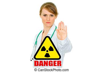 Concept- radiation danger! Strict medical female doctor...