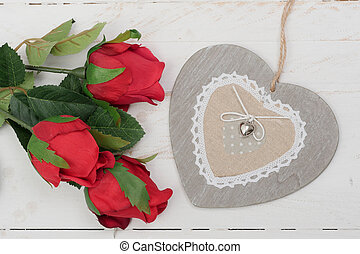 concept romantic,  roses and heart on wooden table