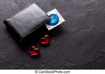concept safe sex with condom on dark background