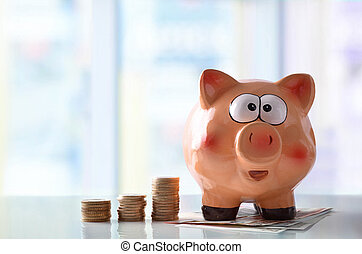 Concept savings with piggy bank and blue glass background