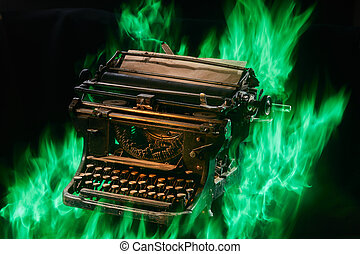 Concept shot of antique manual typewriter with paper burning on black background, selective focus