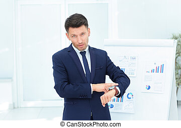 concept - take care of your time. businessman points to his watc