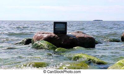 Concept: the love of TV. TV in sea - Concept: ubiquitous TV....
