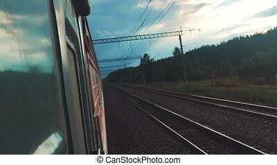 concept travel train wagon journey. View through the train...