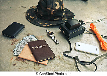 Concept turism. Items include an old photo camera, passport, wallet with currency, hat, and smartphone