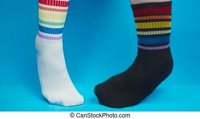 Video of socks with rainbow colors on blue background