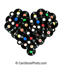 """Concept """"We love music"""" colorful heart shape made of vintage vinyl records, isolated over white background, all labels designed by myself"""