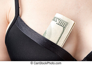 woman with cash in a bra