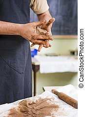 Concepts of Ceramist in Workshop. Closeup of Working Hands...