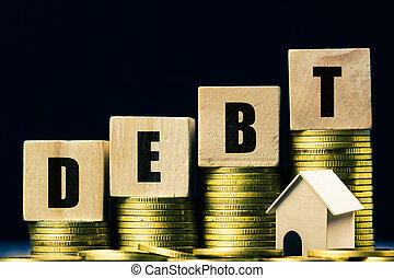 Conceptual about property debt. A small house model with rising stack of coins on dark background. Depicts debt resulting from the purchase of an expensive house