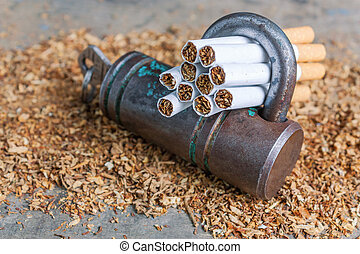 Conceptual antismoking background with broken cigarettes and a padlock