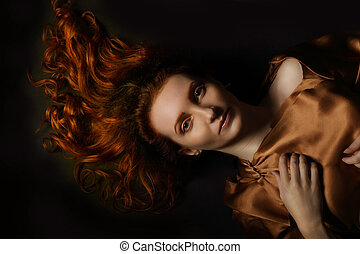 Conceptual art portrait of a young adult red-haired woman