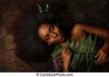 Conceptual art portrait of a young black woman