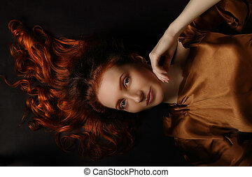Conceptual art portrait of middle-aged red-haired woman